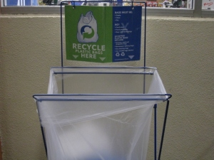 Plastic bag recycling container